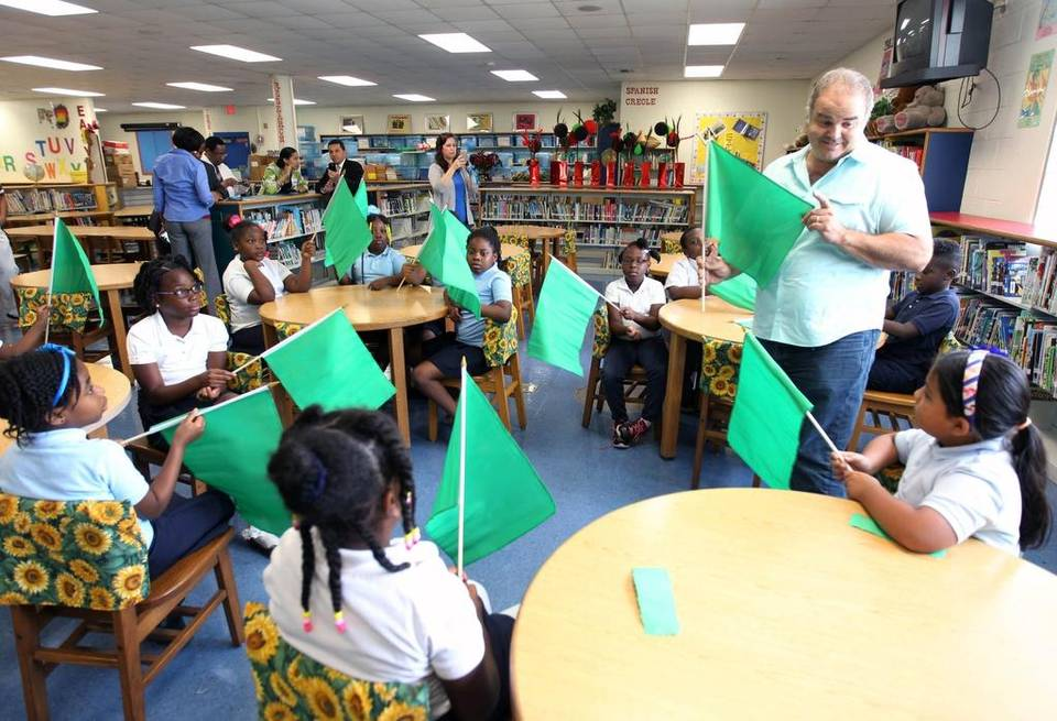 Artist Xavier Cortada talks to students about Earth Day flags. ROBERTO KOLTUN EL NUEVO HERALD Read more here: http://www.miamiherald.com/news/local/education/article19248147.html#storylink=cpy