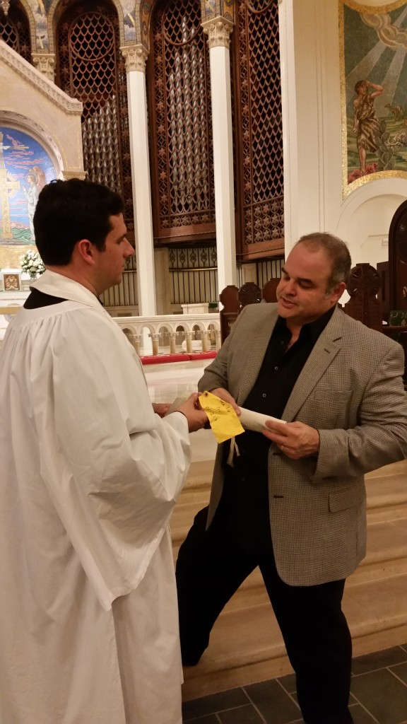 Cortada presents Fr. Grey Maggiano with water from Antarctica for South Pole Communion.